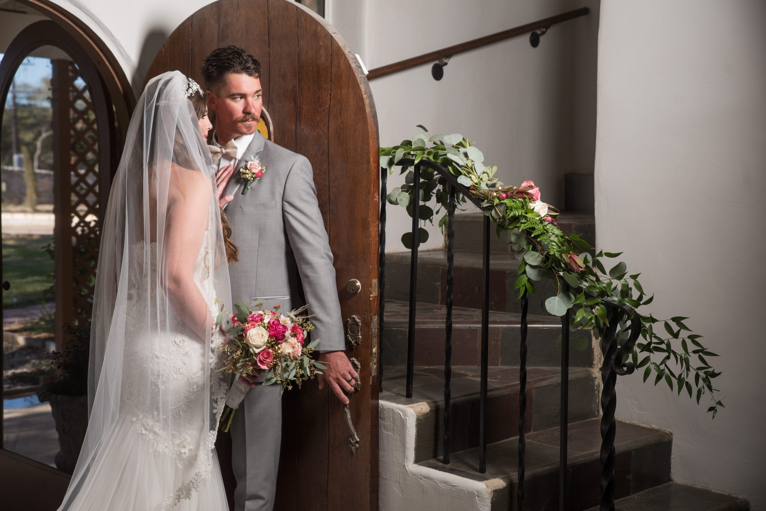 couple standing by a door at Tuscany venue in San Antonio weddings