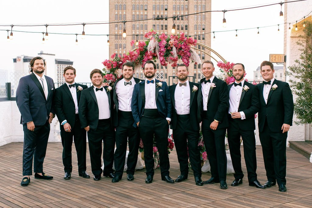 groomsmen looking fresh on the rooftop of the st Anthony hotel in San Antonio Texas