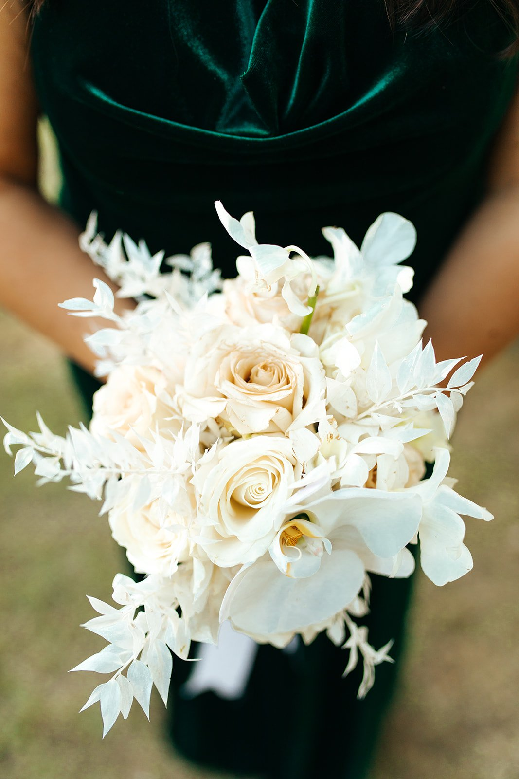 all white wedding floral bouquet and green velvet bridesmaid dress
