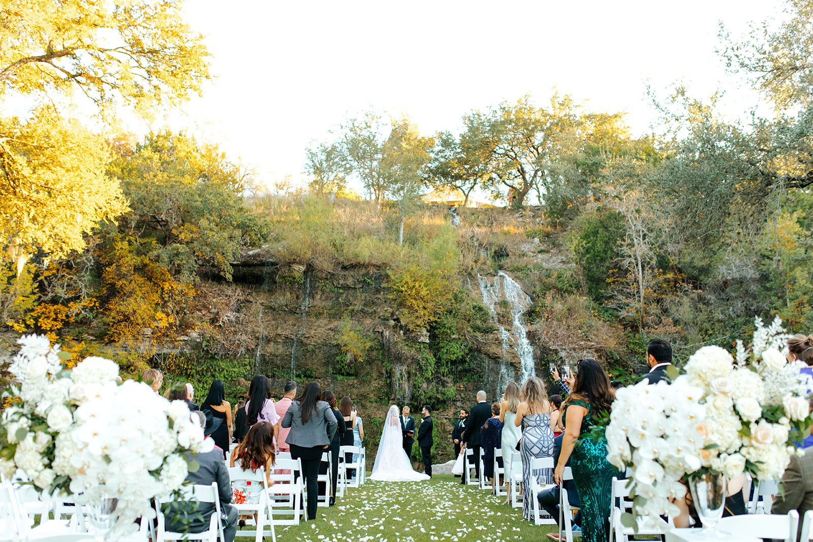 wedding in front of a waterfall hill country