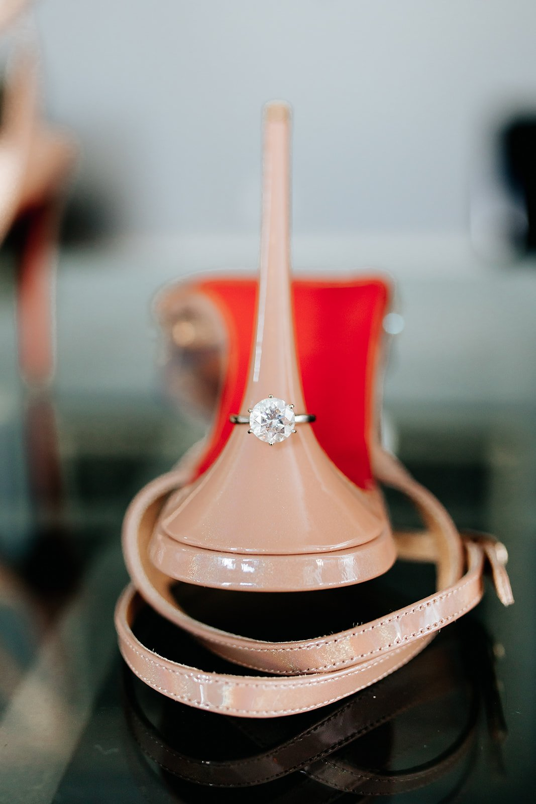 woman engagement ring on the upside down heel with red bottom