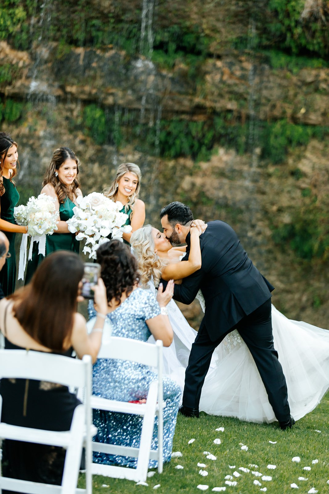 husband dipping his wife during first dance