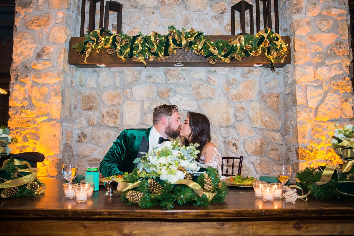 newly wed San Antonio couple at their sweetheart table