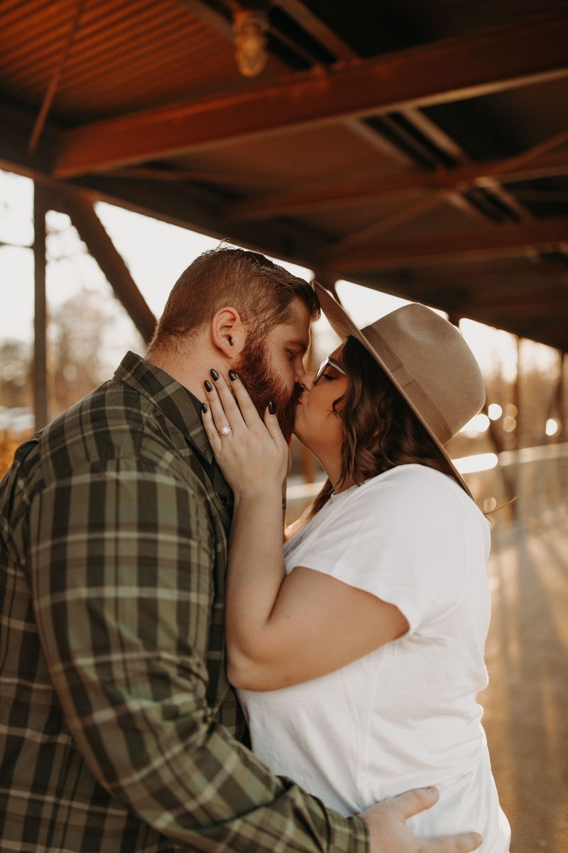 Couple kissing on a bridge