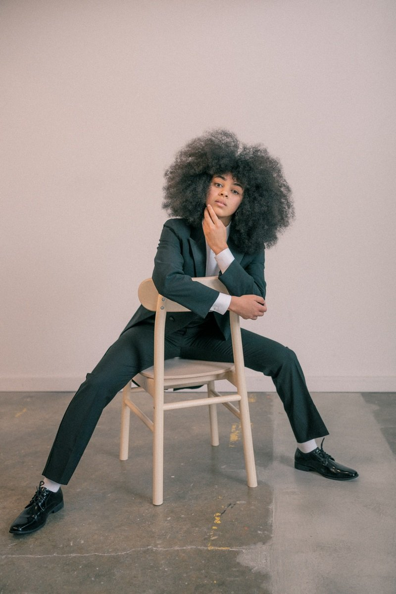 black woman with afro in tuxedo from rex formal wear