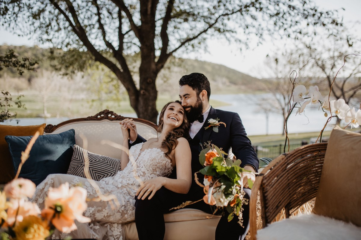 couple sitting in rust and relics furniture rentals at sendera springs in kerrville texas
