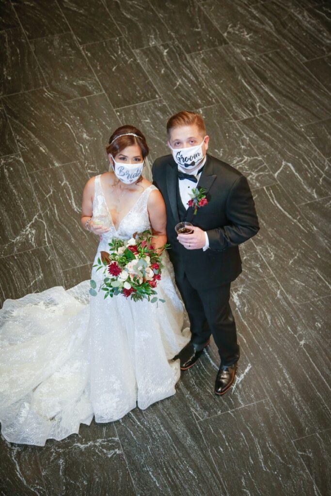 San Antonio Weddings couple, Dax and Yumi, at Frost Tower Dos Kiwis