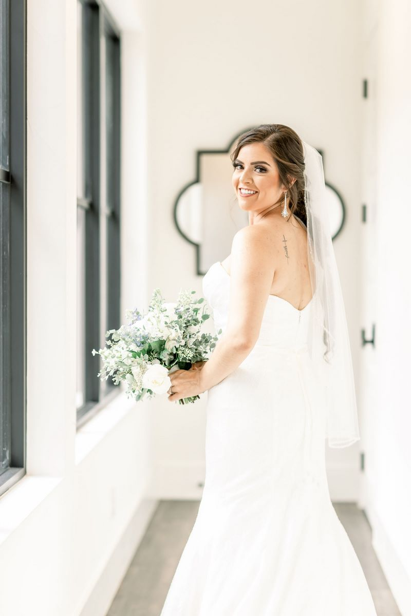 San Antonio Bride standing by window at Hayes Hollow