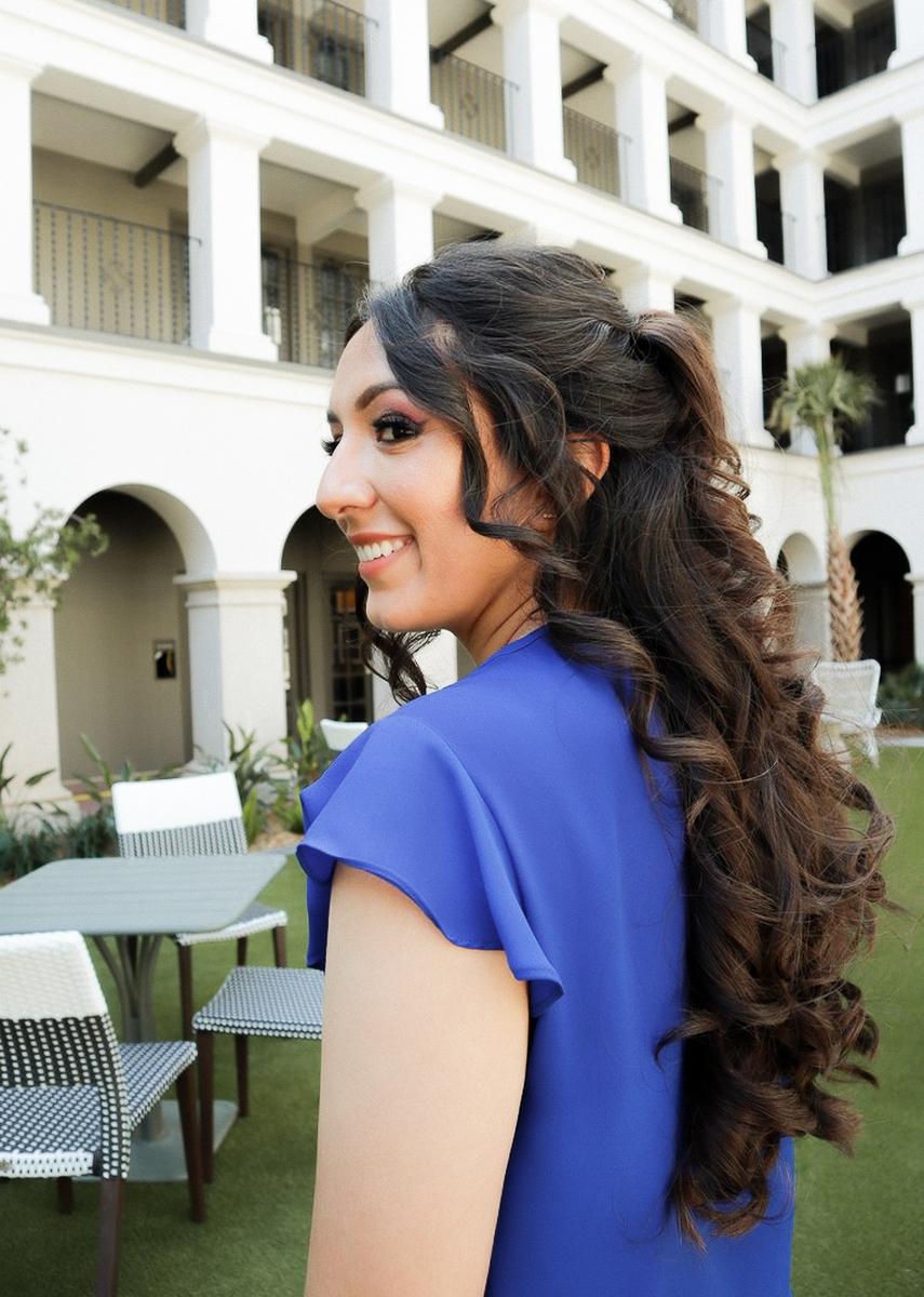 Erika Perez looking off to the side at Estancia Del Norte Hotel in San antonio Texas