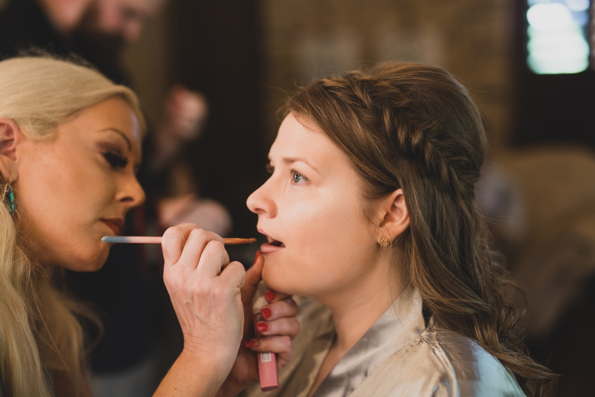 Laura Gorman of Love, Lipstick, and Lashes working on makeup