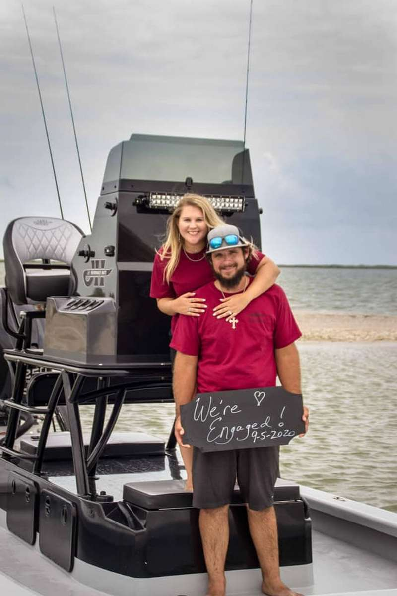 Taylor and Reagan's boat proposal on the water in Texas